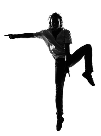 full length silhouette of a young man dancer dancing funky hip hop r&b on  isolated  studio white background Stock Photo - 14683173
