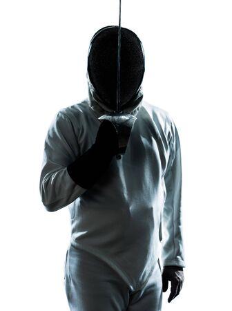 esgrima: una silueta de hombre saludando a la esgrima en el estudio aislado sobre fondo blanco Foto de archivo