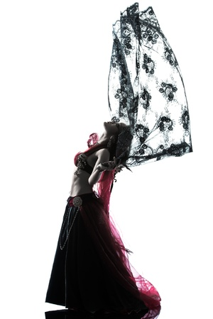 one arabic woman belly dancer dancing silhouette studio isolated on white background photo