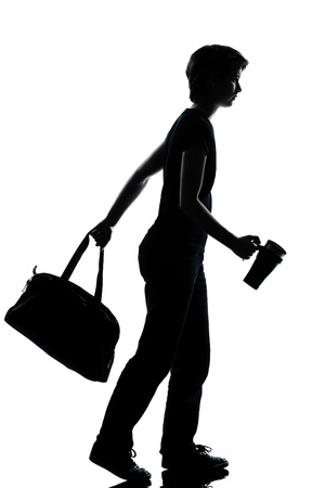 one caucasian young teenager silhouette school boy or girl walking full length in studio cut out isolated on white background photo