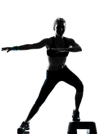 aerobic training: one woman exercising workout fitness aerobic exercise posture on studio isolated white background