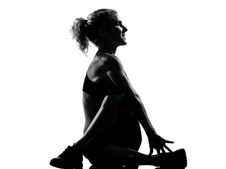 one woman exercising  warming up yoga stretching rotation fitness posture workout  aerobic posture on studio isolated white background Stock Photo - 14683176