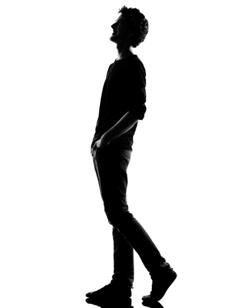 young man  walking  happy laughing silhouette in studio isolated on white background Stock Photo - 14683146