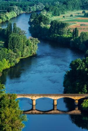 medevial bridge over the dordogne river perigord france photo