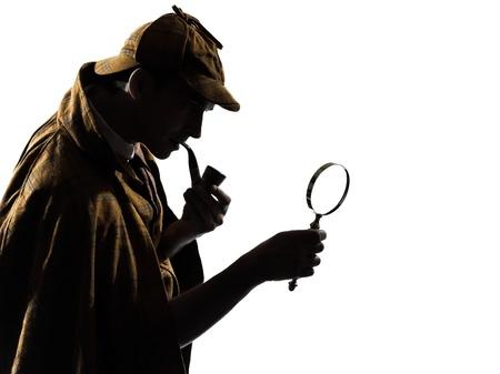 distrust: sherlock holmes silhouette in studio on white background
