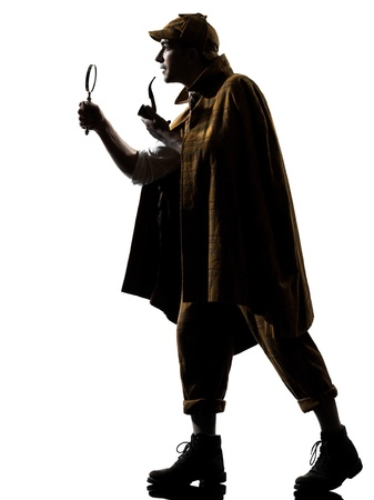 mistrust: sherlock holmes silhouette in studio on white background