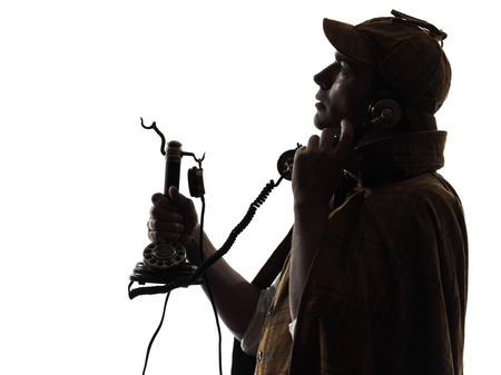 sherlock holmes silhouette on the phone in studio on white background photo