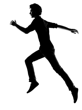 young man  running silhouette in studio isolated on white background photo