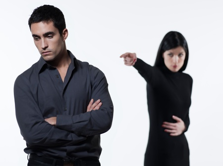 one young couple relationship difficulties dispute with woman crying on studio isolated white background photo