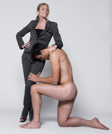 naked female: young couple with man in studio on isolated grey background