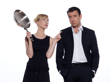 beautiful caucasian couple on studio white background in funny conflict photo
