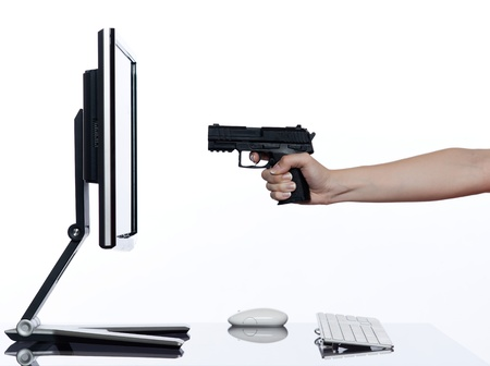 handguns: communication between human hand and a computer display monitor on isolated white background expressing failure gun shoot concept Stock Photo