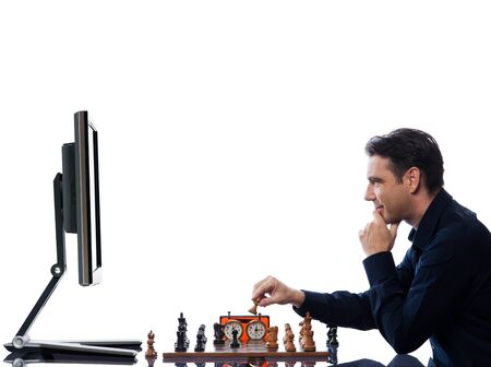 chess player: caucasian man playing chess triumphant against computer  concept on isolated white background Stock Photo
