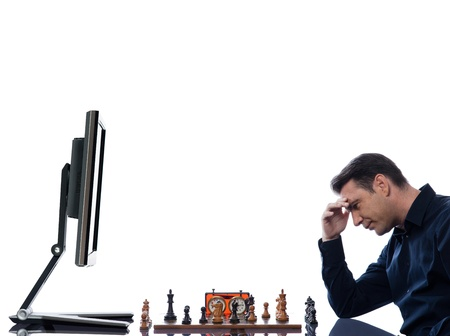 caucasian man playing chess concentrated against computer concept on isolated white background photo