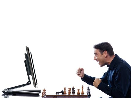 vanquish: caucasian man playing chess victorious against computer concept on isolated white background