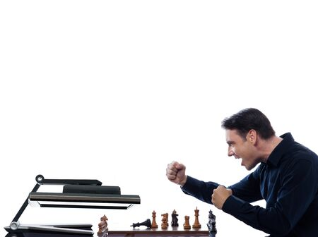 caucasian man playing chess triumphant against computer concept on isolated white background photo