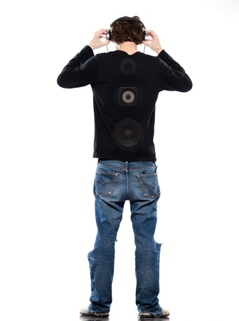 studio portrait of a caucasian young man listening to music on white background photo