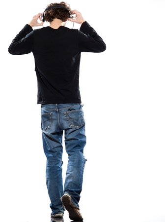 back shots: studio portrait of a caucasian young man listening to music on white background Stock Photo