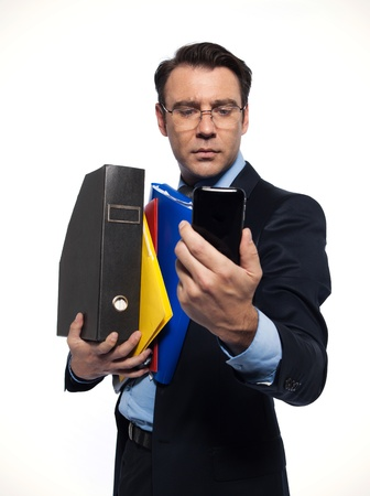 man businessman holding documents looking at phone isolated studio on white background photo