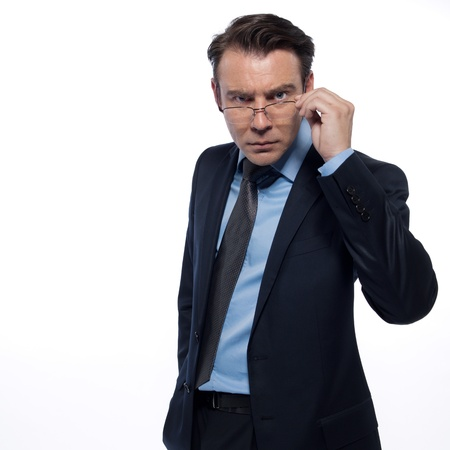 beckon: man businessman intellectual attentive holding glasses isolated studio on white background Stock Photo