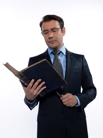 brainy: one man caucasian professor teacher teaching  reading an ancient book isolated studio on white background Stock Photo
