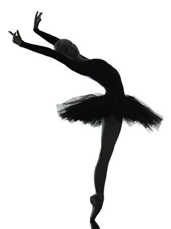 bailarinas: una mujer cauc�sica joven bailarina de ballet bailarina bailando con tut� en el estudio de la silueta en el fondo blanco Foto de archivo
