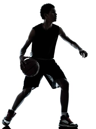 dribbling: one young man basketball player silhouette in studio isolated on white background Stock Photo