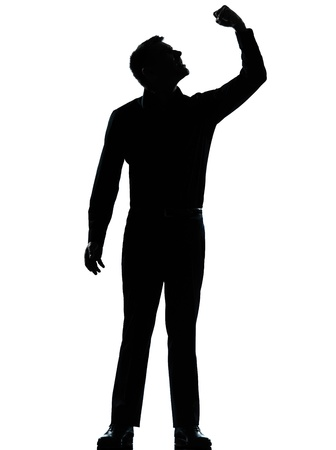one caucasian business man angry fisting up  silhouette standing Full length in studio isolated on white background Stock Photo - 15464908