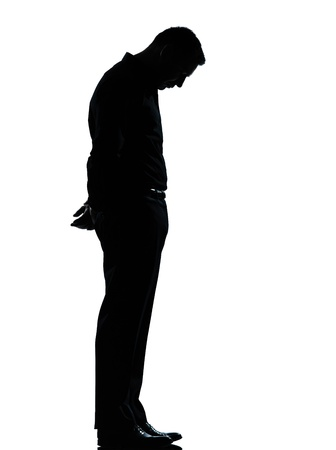 man looking out: one caucasian business man sad lonely silhouette standing Full length in studio isolated on white background