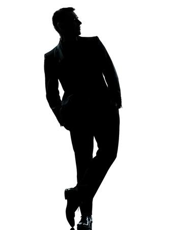 gölge: beyaz zemin üzerine izole stüdyo cebinde Tam boy eller ayakta biri beyaz iş adamı siluet Stok Fotoğraf