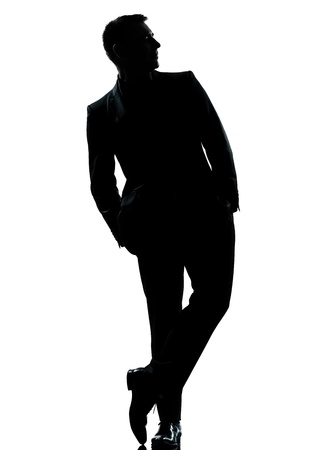 shadow: one caucasian business man silhouette standing Full length hands in pocket in studio isolated on white background Stock Photo