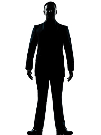 man looking out: one caucasian business man silhouette standing Full length in studio isolated on white background