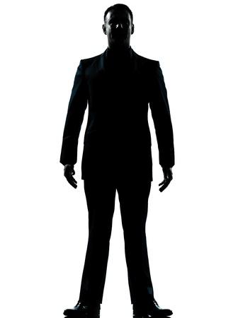 silueta hombre: una empresa cauc�sico silueta hombre de pie de cuerpo entero en el estudio aislado sobre fondo blanco