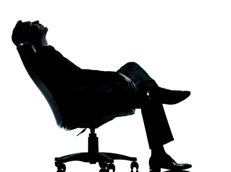 one caucasian business man relaxing  sitting in armchair silhouette Full length in studio isolated on white background Stock Photo