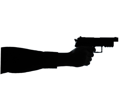 one caucasian close up detail one man hand aiming gun silhouette in studio isolated on white background photo