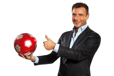 one caucasian business man holding showing soccer ball in studio isolated on white background photo
