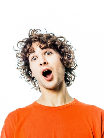 one young man caucasian surprised amazed portrait  in studio white background photo