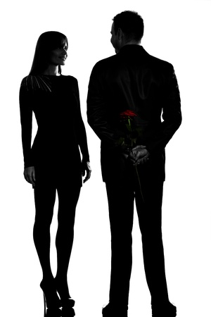 one caucasian couple man and woman smiling in studio silhouette isolated on white background photo