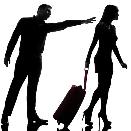 one caucasian couple dispute separation woman leaving and man holding back in studio silhouette isolated on white background Stock Photo - 15483014