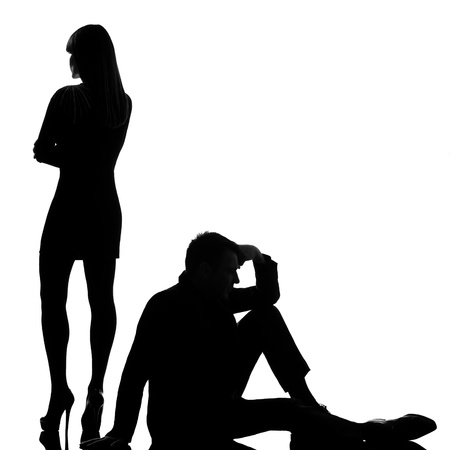 relationship problems: one caucasian couple man and woman dispute conflict full length in studio silhouette isolated on white background