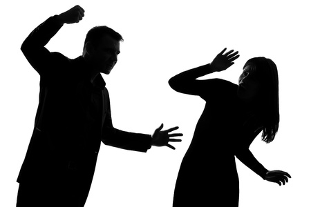 aggressive people: one caucasian couple man and woman expressing domestic violence in studio silhouette isolated on white background Stock Photo