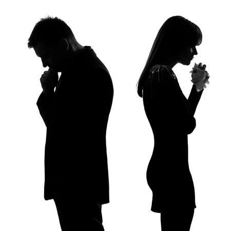to cry: one caucasian sad couple back to back man thinking and woman crying standing back to back man and woman in studio silhouette isolated on white background