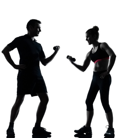 weight weightlifting: one couple man woman exercising workout aerobic fitness posture full length silhouette on studio isolated on white background
