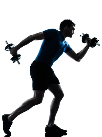 aerobic exercise: one caucasian man exercising weight training workout fitness in silhouette studio  isolated on white background