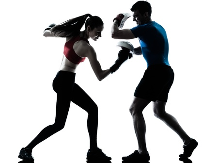boxing sport: personal trainer man coach and woman exercising boxing silhouette  studio isolated on white background