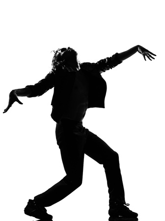 zombies: full length silhouette of a young man dancer dancing funky hip hop r&amp,b zombie walk