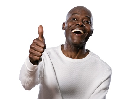 feeling up: Portrait of a very happy afro American showing thumbs up in studio on white isolated background Stock Photo