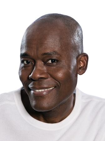Close-up portrait of an attractive afro American man smiling in studio on white isolated background photo
