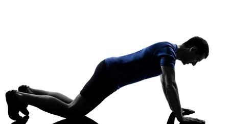 pushups: man exercising push ups workout fitness aerobics posture in silhouette studio isolated on white background
