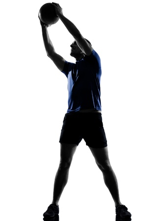 swiss ball: man exercising workout fitness aerobics posture in silhouette studio isolated on white background Stock Photo